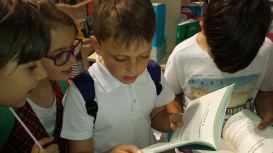 Kids from Class 3 at School 169 check to see how they feature in Dalia's Pet Detectives, at Bookfest